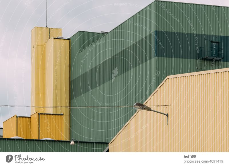 dreary view of a green yellow warehouse Warehouse Harbour Storage Facade Depot Wall (building) Industrial plant Factory Architecture Trade