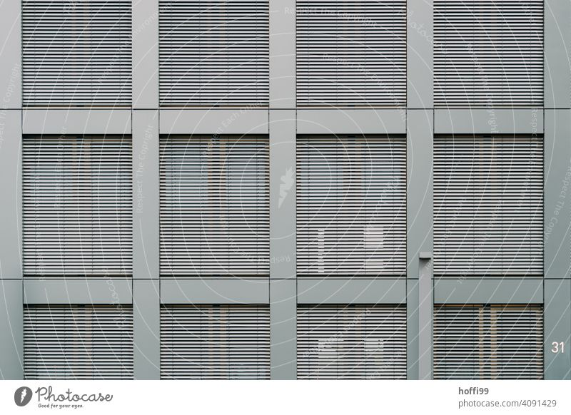 Modern exterior facade with closed blinds Venetian blinds Disk Slat blinds Window Contrast Modern architecture Closed Architecture Facade Roller shutter