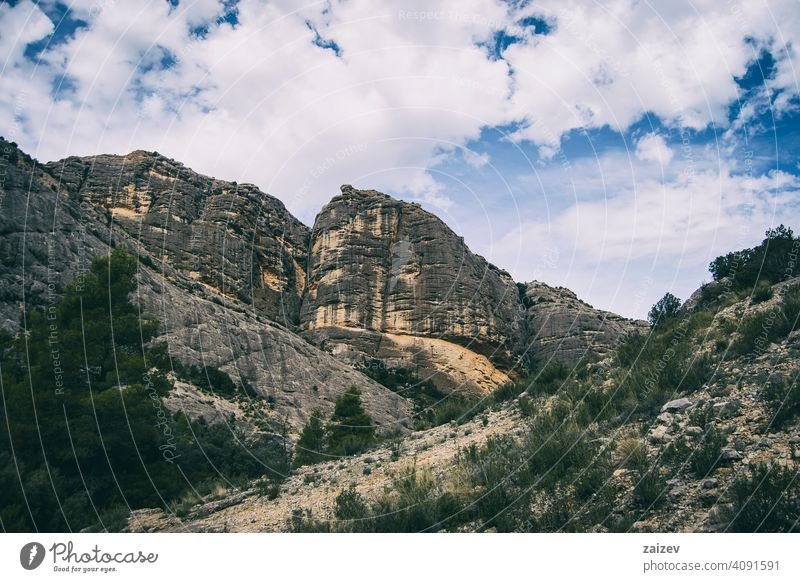 calm stream with many stones on the path eroded layered canyon nature outdoors travel destinations mountain spain tarragona descent moment moody sad stormy