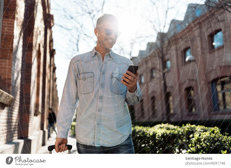 Business casual man using a smartphone. person lifestyle people middle aged handsome senior outdoors caucasian city adult male portrait urban confident fashion