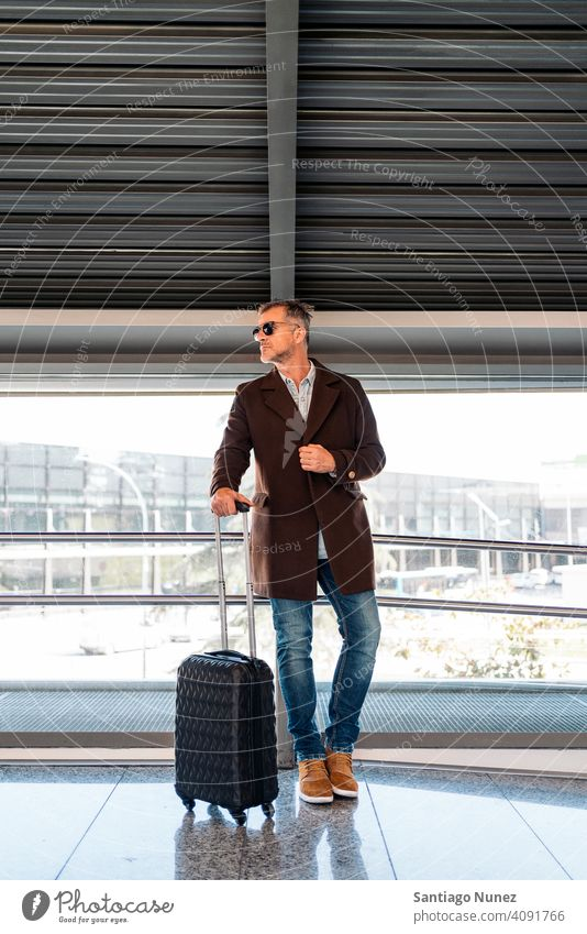 Caucasian business man at airport person lifestyle people middle aged handsome senior caucasian city adult male portrait casual urban confident fashion