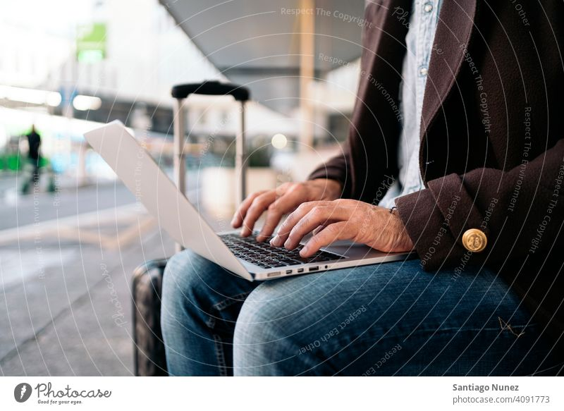 Close up of an unrecognizable business man using laptop. close up type 50s hands person lifestyle people middle aged handsome senior outdoors caucasian city