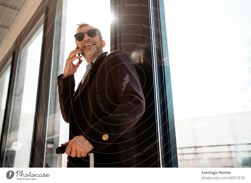 Casual business man on the phone. person lifestyle people middle aged handsome senior caucasian city adult male portrait casual urban confident fashion