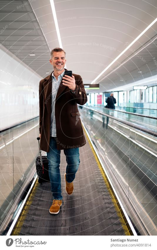 Caucasian business man at airport. person lifestyle people middle aged handsome senior caucasian city adult male portrait casual confident fashion grey hair