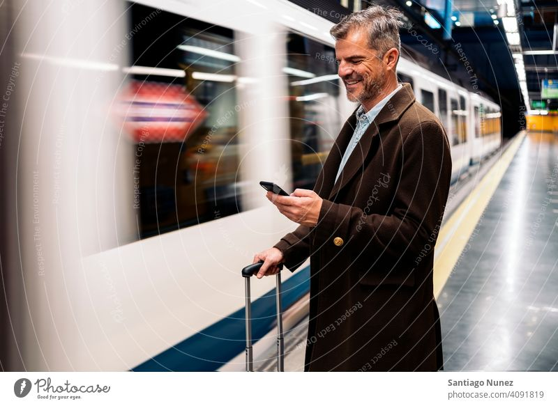 Business man using smartphone in the underground. person lifestyle people middle aged handsome senior caucasian city adult male portrait casual urban confident