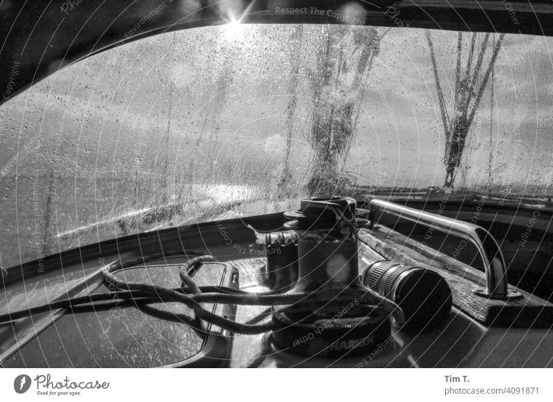 Sprayhood after the rain . Sun Sailing bnw sailing ship Sailing ship raindrops Ocean Sky Watercraft Sailboat Summer Aquatics Clouds Yacht Exterior shot
