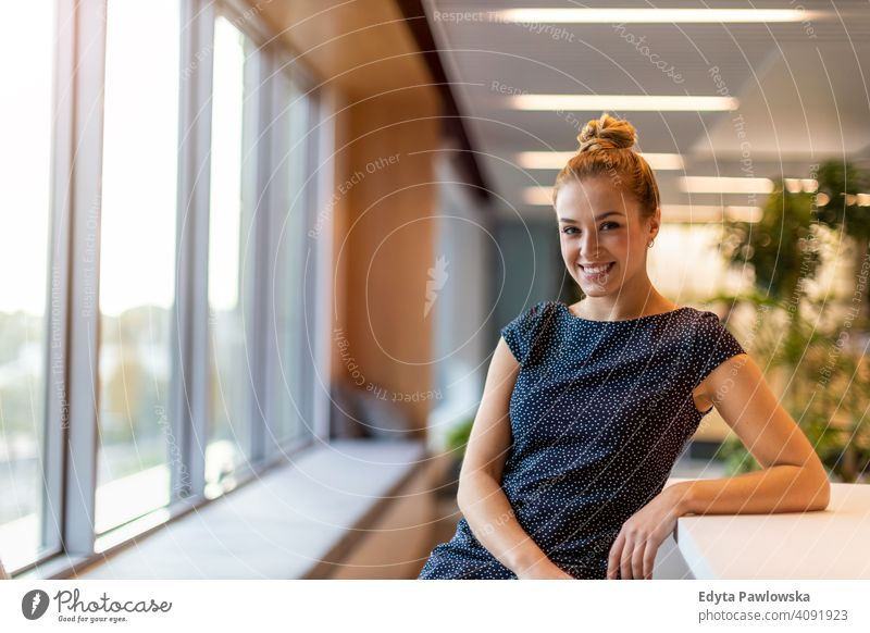 Smiling woman in the office girl people Entrepreneur business businesswoman successful professional young adult female lifestyle indoors millennial attractive