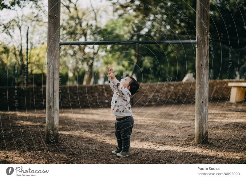 Child playing in the park childhood 1 - 3 years Caucasian Spring color Park Playing Playground Growth Small Infancy Lifestyle Leisure and hobbies Happy