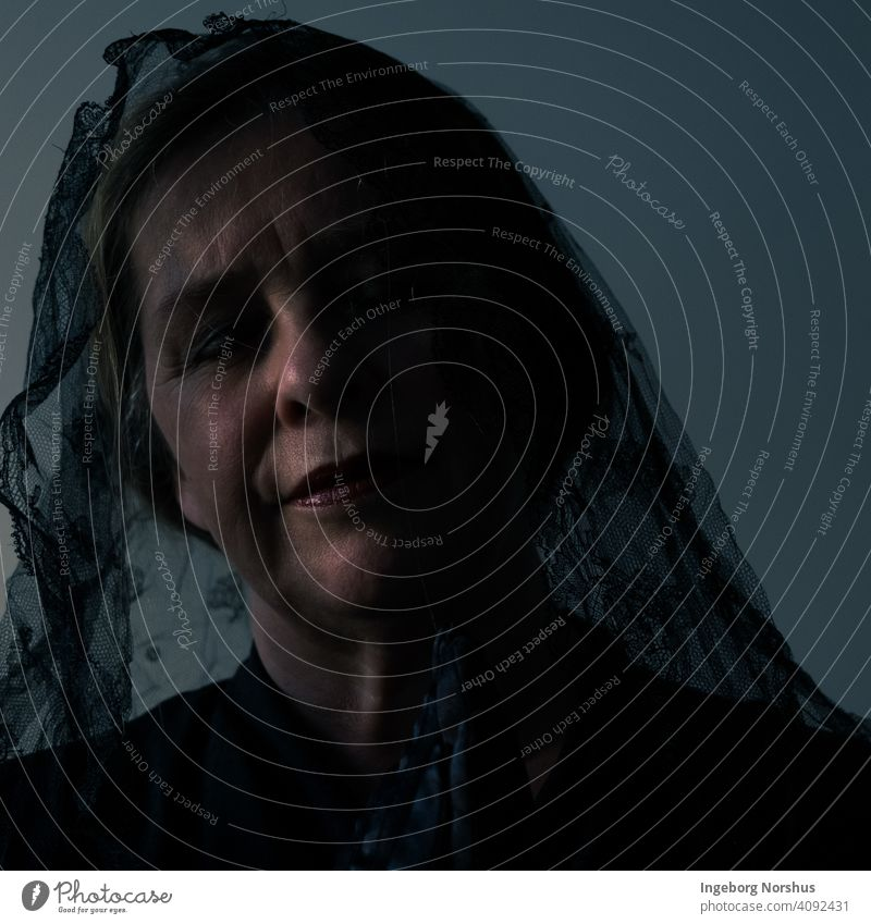 Veiled woman partly in shadow with blue/gray background portrait Portrait photograph veiled Self portrait Woman contemplation Contemplative mournful mourning