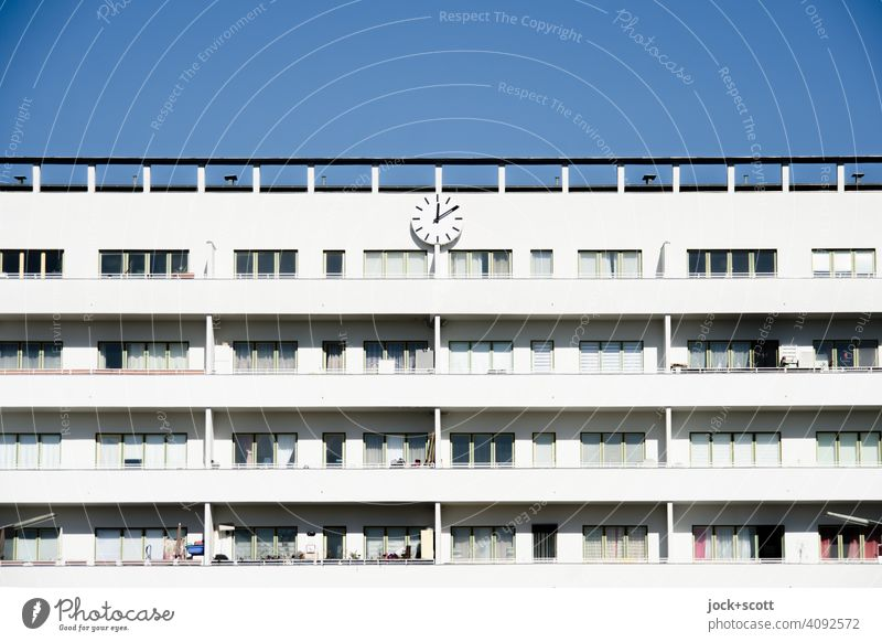 10 past 12 shows the clock on the facade Clock white city Modern architecture Berlin Reinickendorf Symmetry Balcony Facade Apartment Building