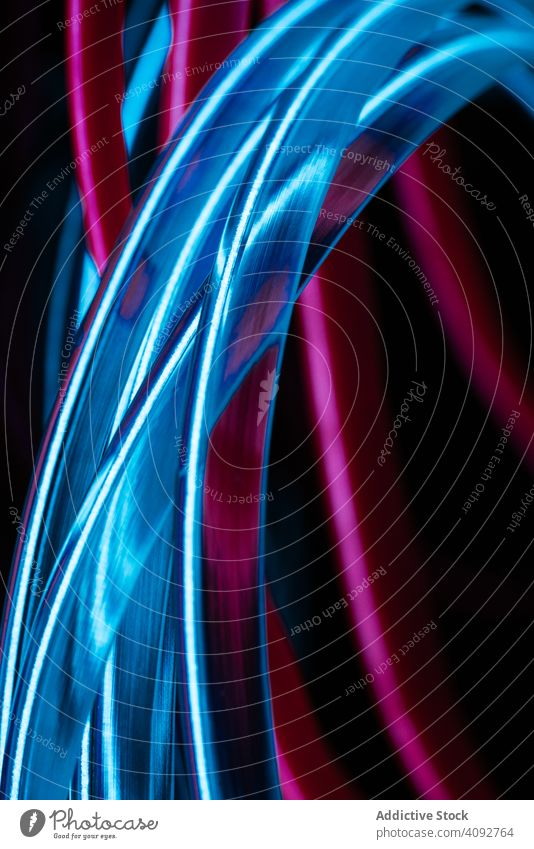Stack of neon light tubes abstract art creative bright colorful beautiful connection curve line shape texture illustration image graphic concept blue pink