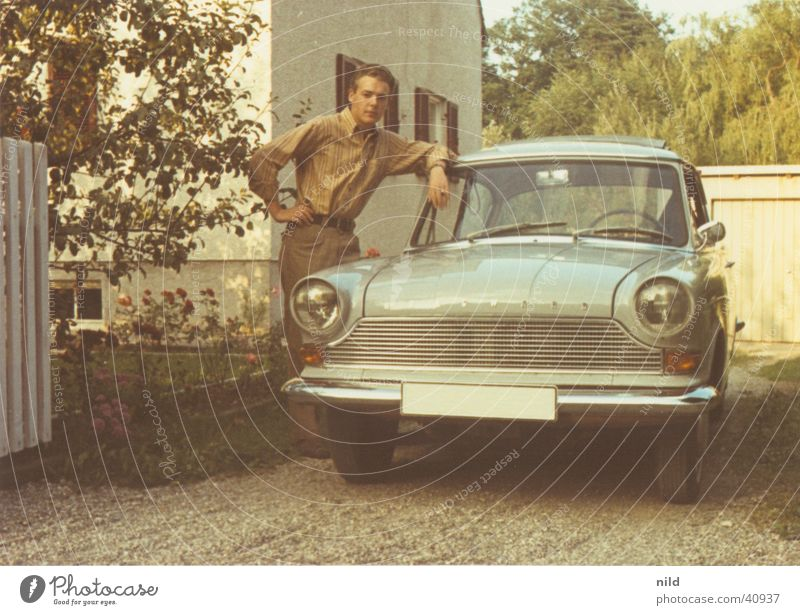 The first car Vintage car Sixties Easygoing Nostalgia Radiator  grille Carriage Posture Joint Human being Cool (slang) Pride borgward garage entrance Slate blue