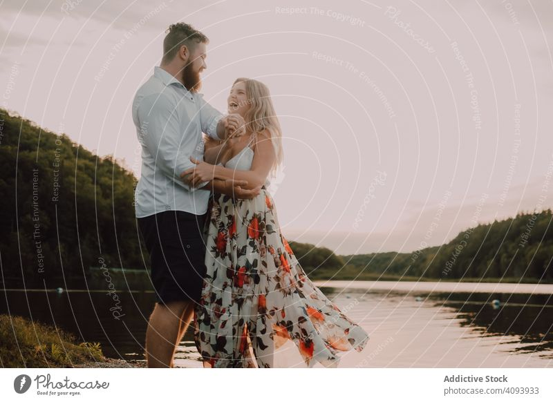 Loving couple standing ankle deep in water on beach hug love lake tender shore adorable embrace coast vacation nature honeymoon caress together affection