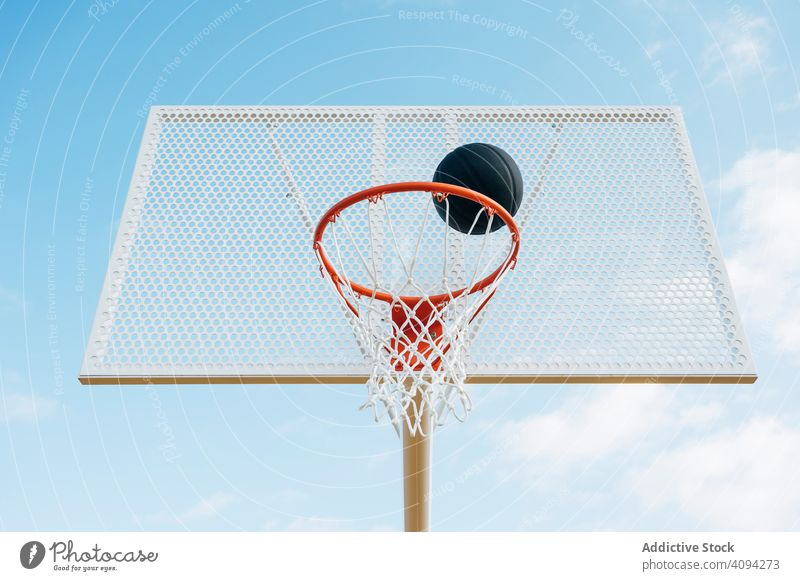Outdoor basketball court and black ball man athlete competition sports equipment adult recreation action portrait active activity asphalt athletic city drop