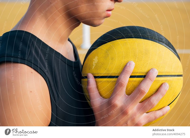 crop Young man and ball playing on basketball court outdoor. athlete competition sports equipment adult recreation action active activity asphalt athletic city