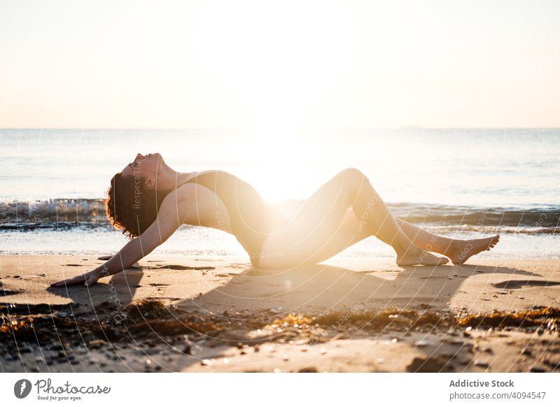 Slim woman relaxing on beach near sea sensual swimwear wave sky cloudless sunny slim female barefoot summer lifestyle ocean water vacation weekend travel trip