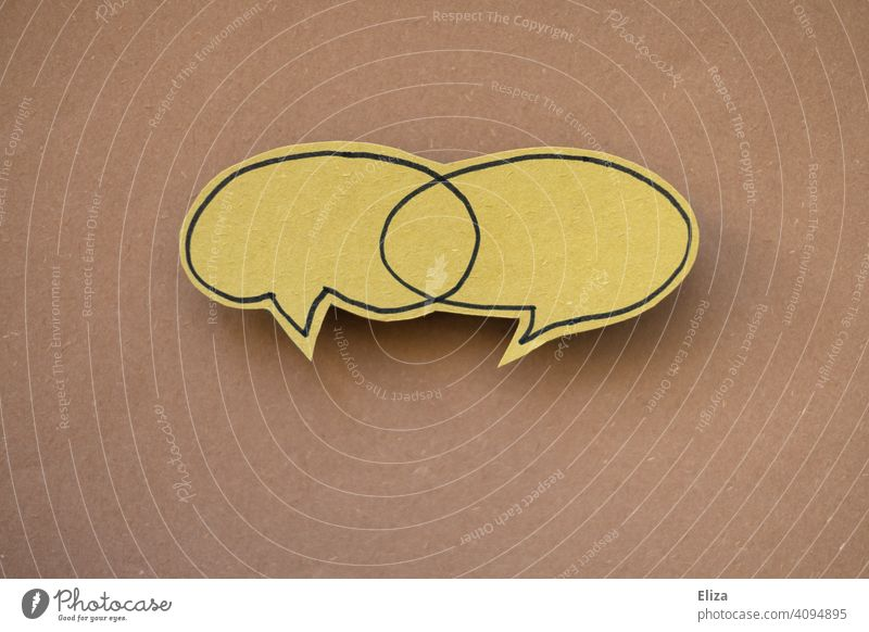 Two speech bubbles with an intersection. Communication, discussion and dialogue. communication To talk togetherness Speech bubbles Smiley two cutting quantity