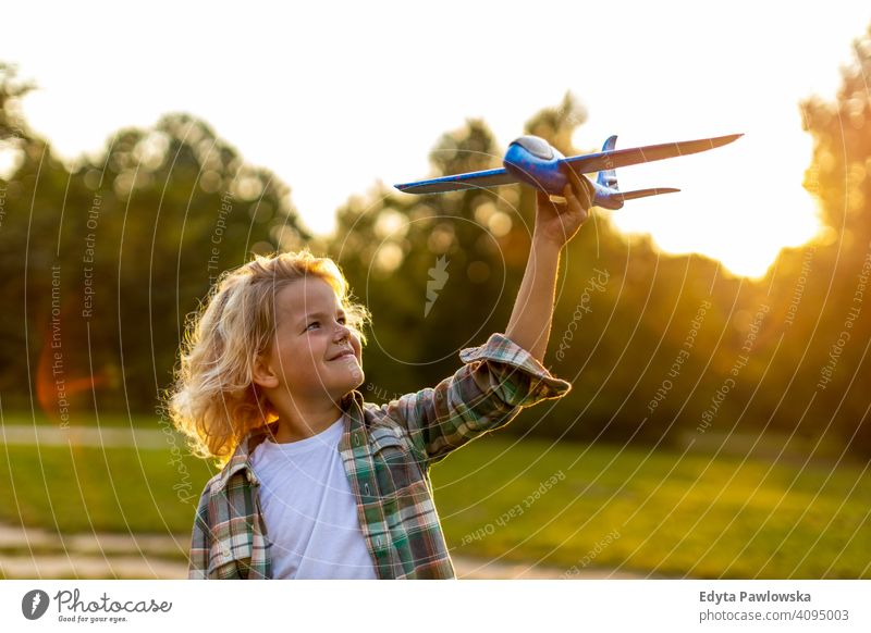 Little boy playing with toy plane in park people child little boy kids childhood outdoors casual cute beautiful portrait lifestyle elementary leisure preschool