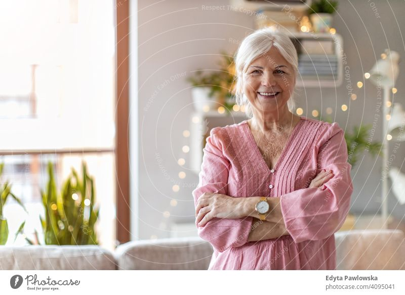 Confident senior woman in her home happy smiling enjoying positive confident content people one person mature pensioners retiree retired retirement old elderly