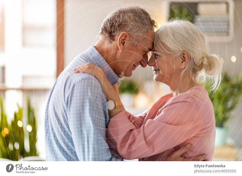 Happy senior couple at home people woman adult mature casual attractive female smiling happy Caucasian toothy enjoying two people love relationship portrait