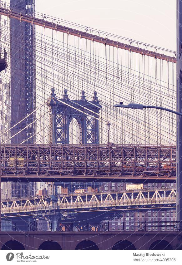 Brooklyn Bridge and Manhattan Bridge at sunset, color toning applied, New York City, USA. city bridge retro vintage landmark travel NYC architecture purple