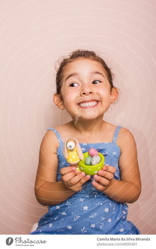 Happy child holding plate with mini chocolate eggs. april candy celebration childhood colorful copy space decoration dessert easter festive food fun happy