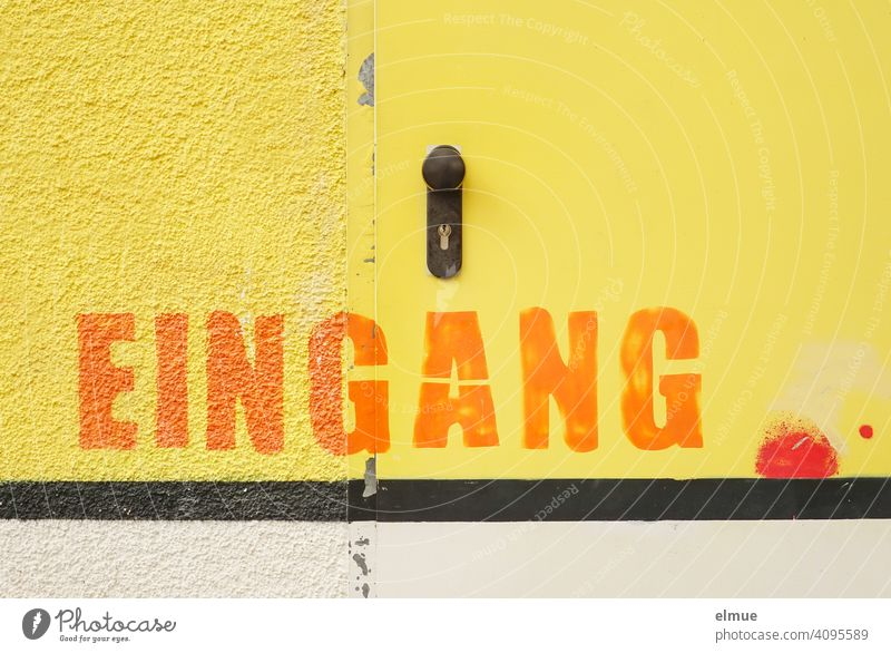 Wall and door are painted yellow and above a black stripe you can read in big orange letters EINGANG / Color Entrance Colour Stripe Wall (building) Yellow