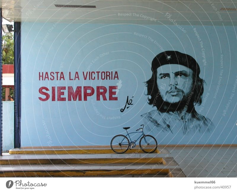 Hasta la Victoria Siempre Wall (building) Painting and drawing (object) Bicycle Bus terminal Cuba South America che guevara Drawing Reunification Blue