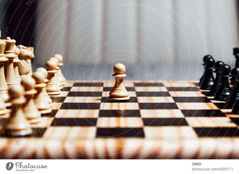 Lonely white pawn starting chess game competition strategy success play intelligence piece challenge knight victory black chessboard leadership move power