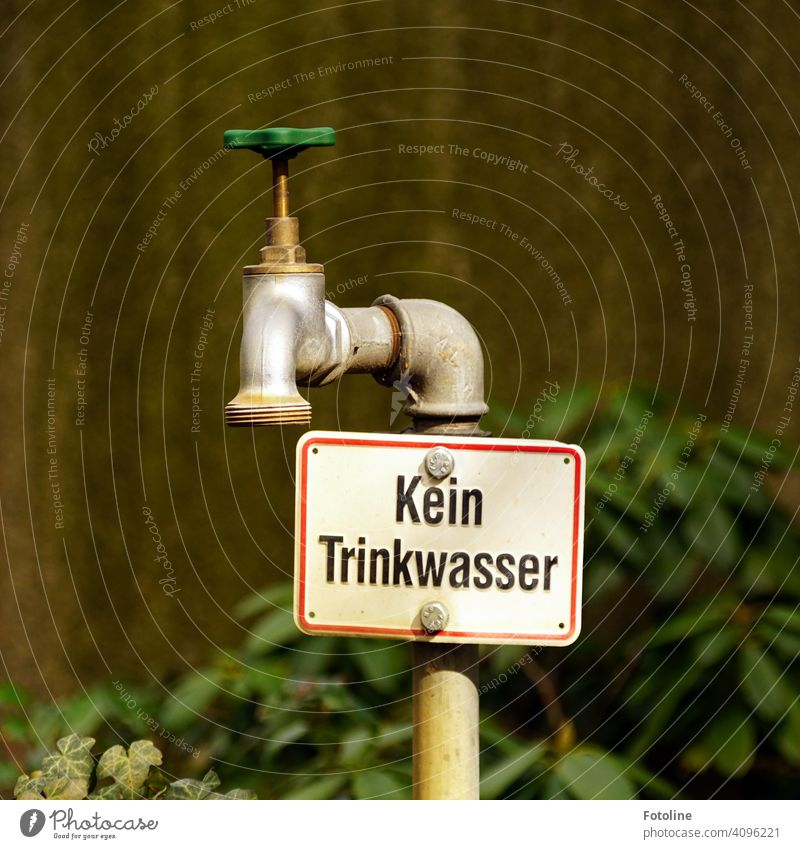 """""""No drinking water"""" is written directly under the old water tap Tap Old Wheel Metal Iron Iron-pipe Rust Deserted Exterior shot Close-up Detail Day Colour photo"""