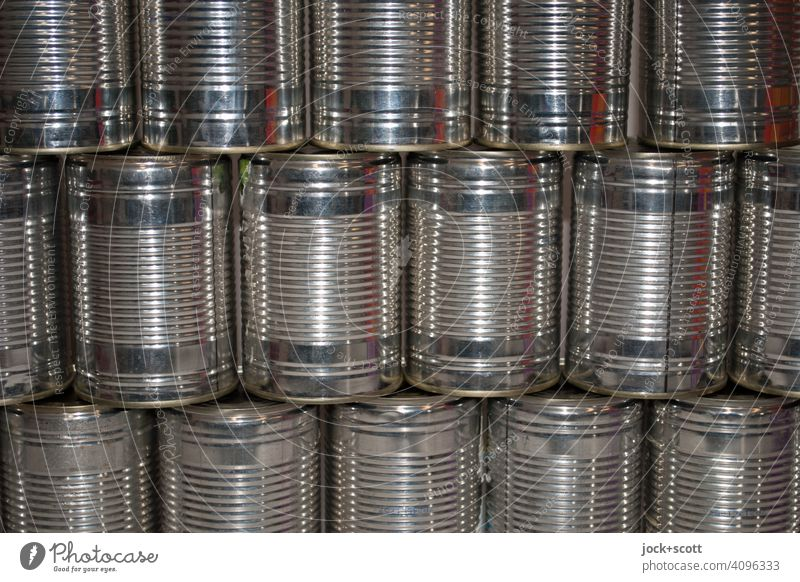Rows of tins without label Glittering Symmetry Classification Containers and vessels Structures and shapes Collection Design Detail Aluminium Metal Many Stack