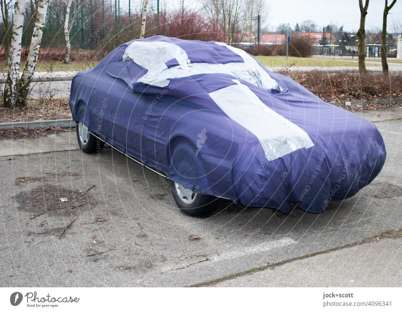 patched-up car tarpaulin for the family carriage Protection Structures and shapes Parking lot Outskirts Protective cover mark Concrete slab Marzahn Berlin mend