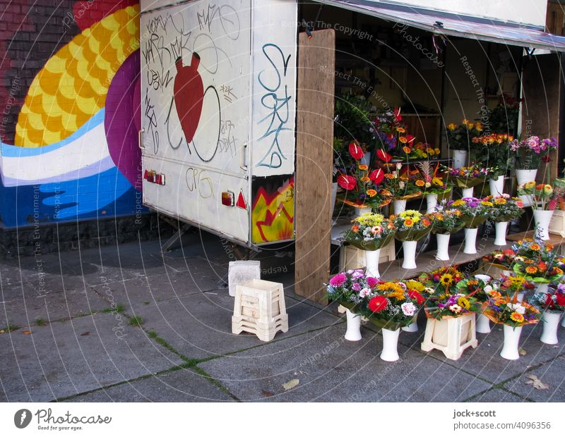 shabby sales trailer with fresh flower bouquets flowers Flower stall Stall assortment Selection Authentic open Graffiti Street art Daub wall design Dirty