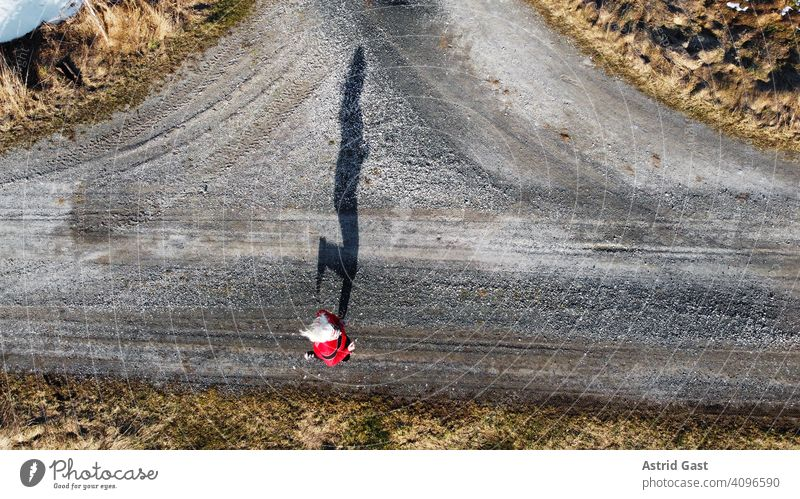 Aerial shot with a drone of a jogger on a street with shadow Aerial photograph drone photo Spring Sports Jogging Woman Walking Running Street