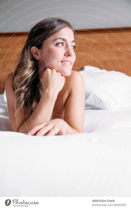 Girl in a bed lit with window light in the morning pretty awake joy girl beauty indoors view home lying down sleep rest lifestyle beautiful waking young