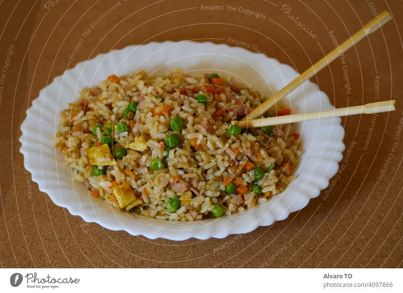 Delcious Special Fried rice in a white dish and Asian Chopsticks cooking sauce meat egg special china dinner plate cooked asian food stir fry spicy