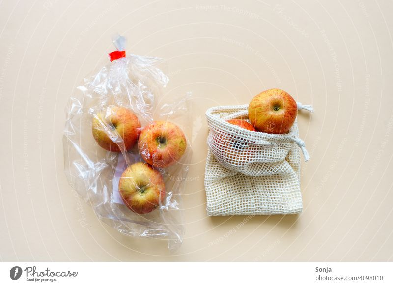 Red apples packed in plastic and in a reusable shopping net Apple Plastic bag String bag Reusable naturally fruit Organic produce Healthy Eating Environment