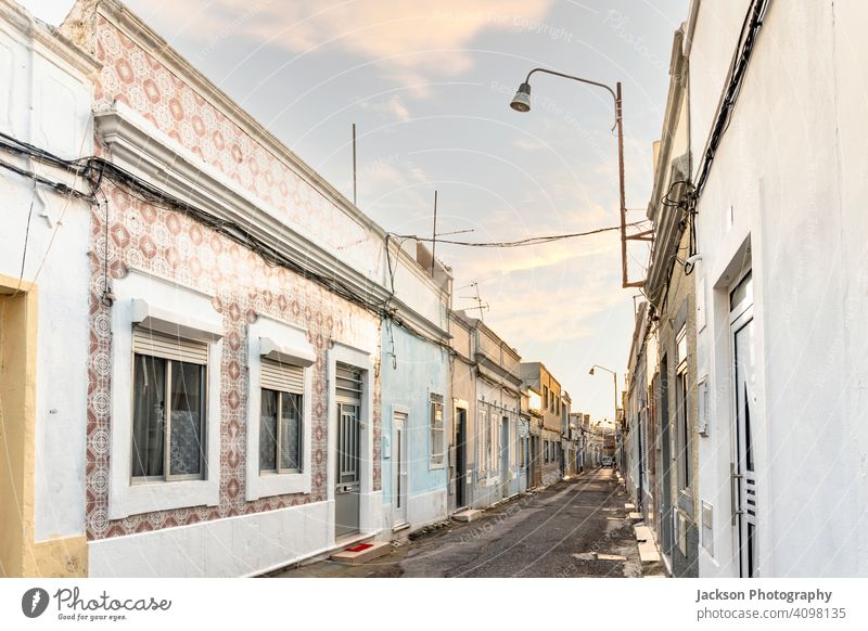 Small houses on the narrow street of historic Olhao, Algarve, Portugal olhao algarve portugal abandoned afternoon architecture blue building city cityscape