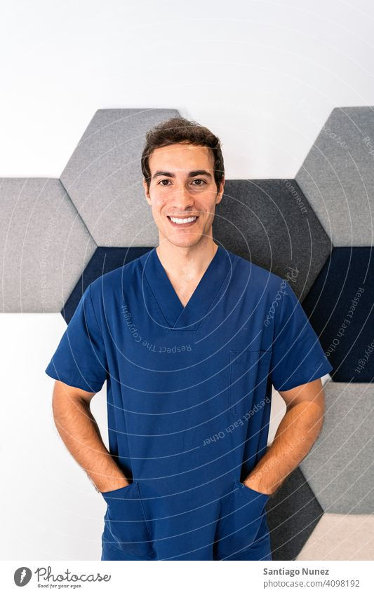 Male Dental Clinic Worker male man doctor uniform work uniform dental clinic looking at camera smiling indoors background portrait work clothes alone one person