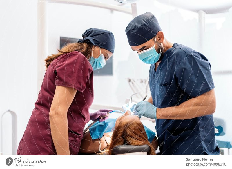 Dental Clinic Workers back view man woman patient standing looking examining dentist clinic dental clinic lying health care equipment medicine medical treatment