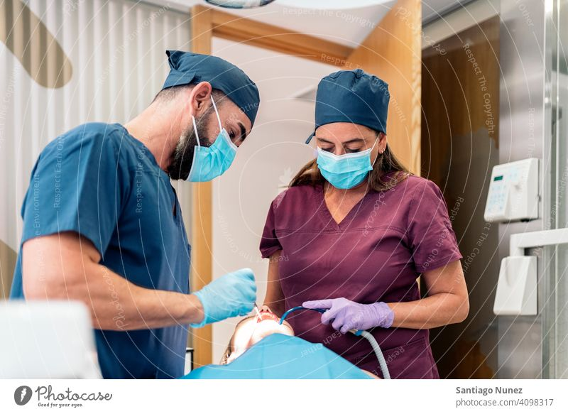 Dental Clinic Workers front view man woman patient standing looking examining dentist clinic dental clinic lying health care equipment medicine medical