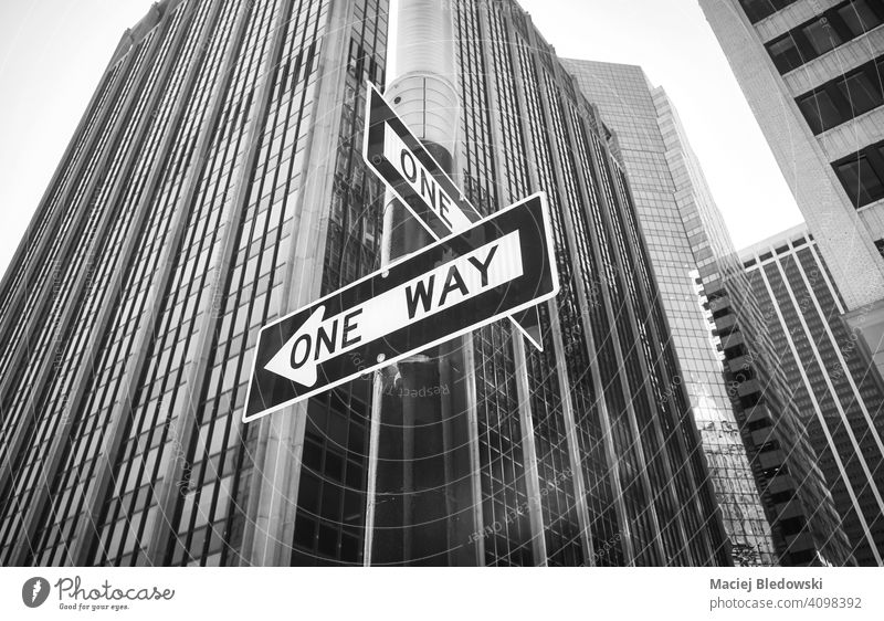 One Way street signs on a lamp post, New York City, USA. one way city black and white NYC Manhattan cityscape B&W building travel transport new york downtown