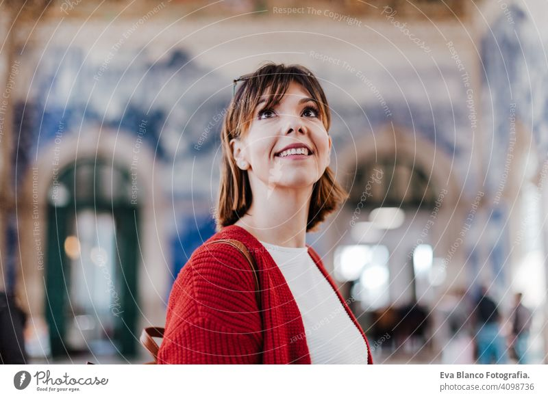 beautiful caucasian woman in train station waiting to travel. Travel and lifestyle concept city public transport boards young trip screen passenger wagon