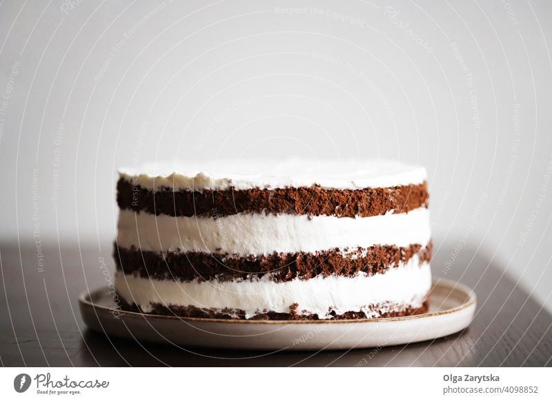 Three layers of chocolate cake with a whipped cream filling. Chocolate Cake Cream cute sponge cake Food Self-made Dark biscuits Tasty Brown Dessert Cooking
