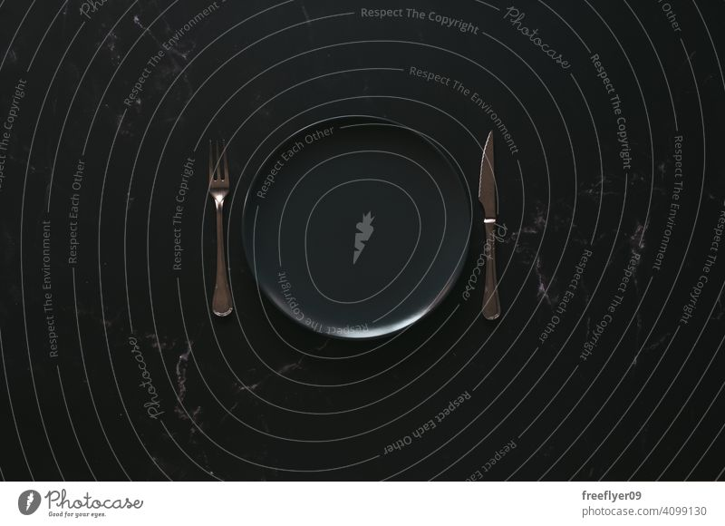 Mockup of an empty plate against a luxurious background mockup cutlery black dark luxury food copy space marble stone flat lay mock up still still life