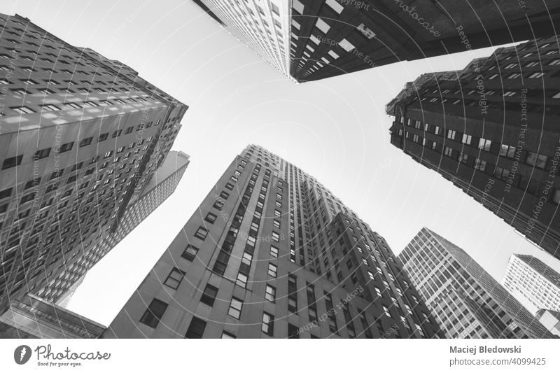 Looking up at Manhattan buildings, black and white picture, New York City, USA city business skyscraper office look up cityscape skyline NYC B&W travel new york