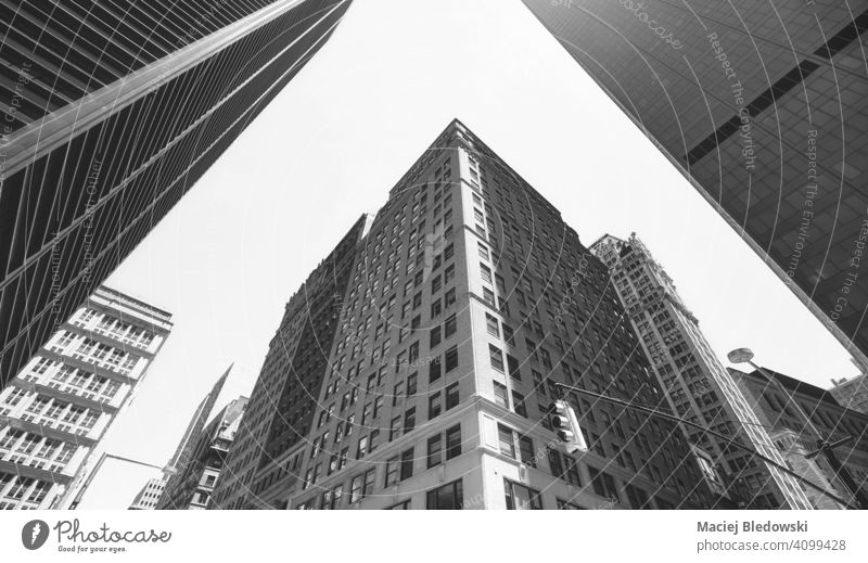Looking up at Manhattan buildings, black and white picture, New York City, USA. city business skyscraper office look up cityscape skyline NYC B&W travel new