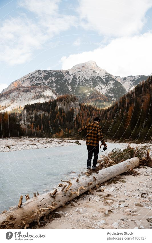 Man delighting in views near lake and mountains tourism water boat fog cloudy mist travel landscape vacation adventure nature beautiful sky scenic holiday rock