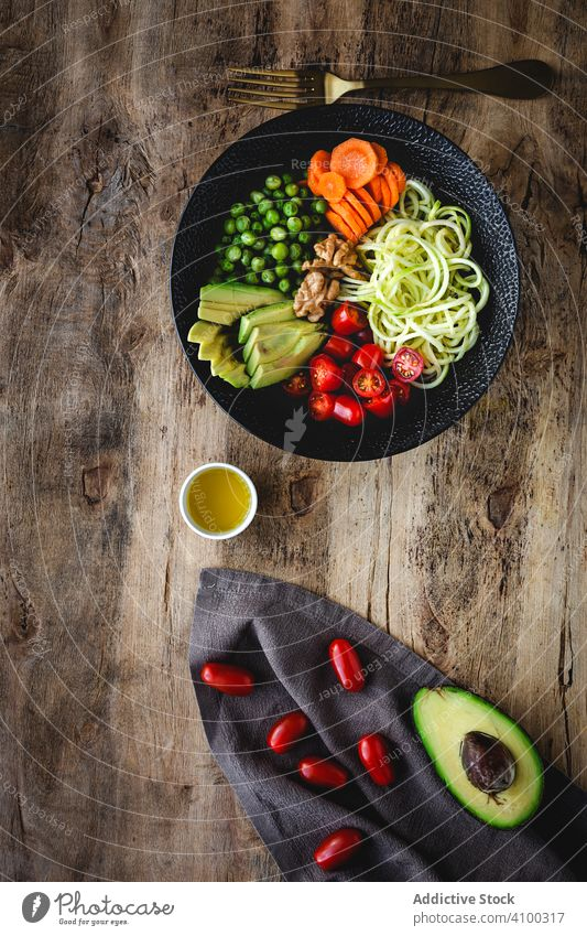 Zucchini raw vegan pasta with assorted vegetables. Vegan food zucchini vegetarian healthy detox lunch salad diet spaghetti cuisine organic green meal noodles
