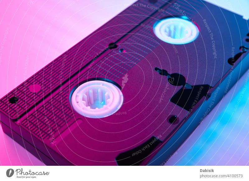 Video cassete on the color background. Retro vhs cassette tape video retro vintage neon computer fashion design frame party icon technology plastic old movie